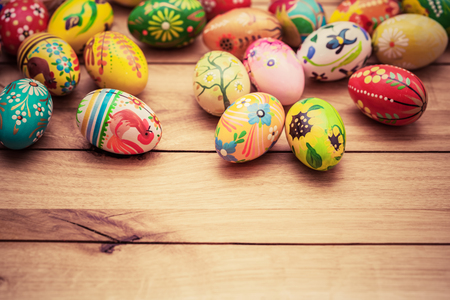 Colorful hand painted Easter eggs on wood. Traditional decoration, unique handmade design. Vintage
