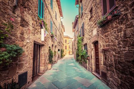 italy street: Charming narrow street in an old Italian town of Pienza. Tuscany, Italy. Vintage Stock Photo