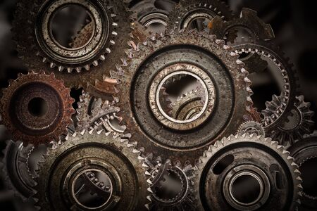 cog wheels: Grunge gear, cog wheels mechanism background. Industry, science concepts. Authentic motor parts. Stock Photo