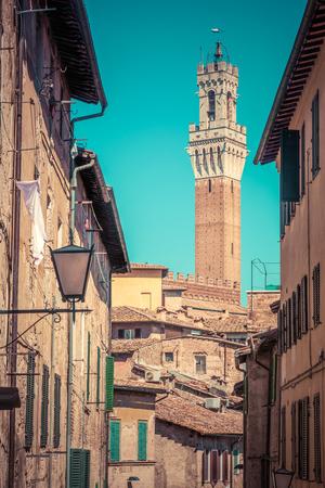 italian architecture: Siena, Italy. Mangia Tower, Italian Torre del Mangia. Medieval architecture. Tuscany region. Vintage