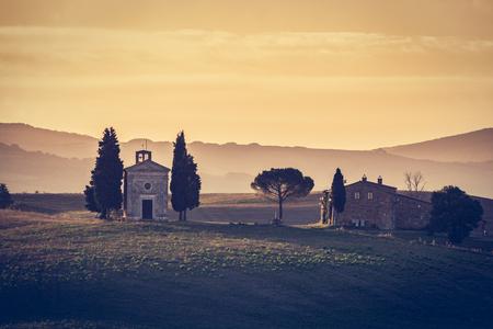 san quirico: Tuscany landscape at sunrise with a chapel of Madonna di Vitaleta, San Quirico dOrcia, Italy. Vintage