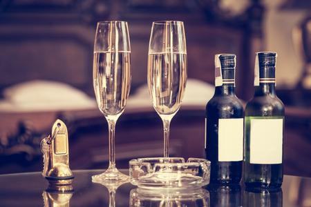 concept hotel: Champagne, glasses, antique keys. Luxury hotel apartment, room service concept. Vintage, retro. Stock Photo
