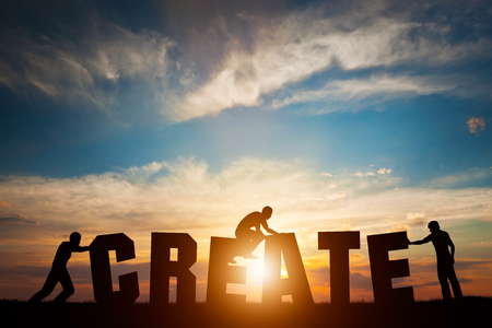 People connect letters to compose the CREATE word. Creativity, making art, teamwork concept, idea. Sunset positive light.