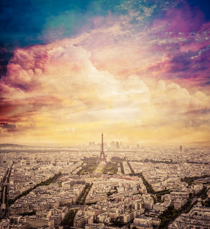 romantic sky: Paris, France skyline with fantastic unique sunset sky. Eiffel Tower in romantic, warm light.
