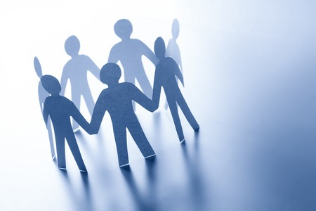 Paper people standing together in circle. Team, business teamwork, global connection concept.