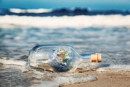 ecosystems: Earth in the bottle coming with wave from ocean. Concept of environment, nature care, save clean world message. Elements of this image furnished by NASA Stock Photo