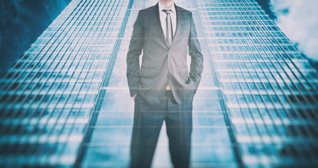 rise: Reflection of a businessman in modern skyscraper. Concept of business leader, future career, growth perspective