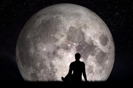 L'homme assis seul sur l'herbe et la recherche sur la lune. Imaginez le futur concept. rendu 3D. Les éléments de cette image fournie par la NASA