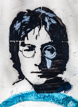 john: PRAGUE, CZECH REPUBLIC - APRIL 29, 2016: John Lennon Wall, portrait. The wall has been filled with Lennon inspired graffiti and lyrics from Beatles songs since 1980s as irritation of the communism