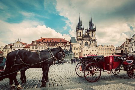 historic site: Old Town of Prague, Czech Republic. Horse carriage for tourists on the square with view on Tyn Church. Vintage Editorial