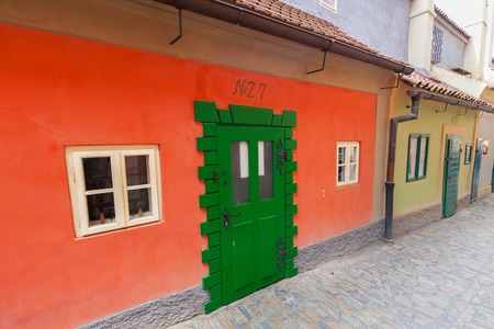 lived here: PRAGUE, CZECH REPUBLIC - APRIL 28, 2016: Golden Lane, Czech Zlata Ulicka is a very popular tourist attraction thanks to its legends as if 16th century alchemists worked here. Franz Kafka lived here Stock Photo