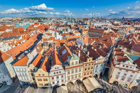 tenement: Cityscape of Prague, Czech Republic. View on traditional red roof tenement houses as seen from Old Town City Hall. Blue sunny sky, wide angle skyline