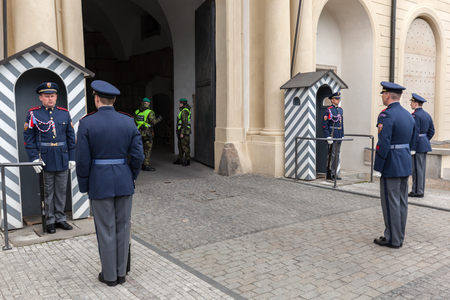 unesco in czech republic: PRAGUE, CZECH REPUBLIC - APRIL 28, 2016: Changing of the guards of Prague Castle. Its main task is to guard and defend the seat of the President of the Czech Republic at the Prague Castle
