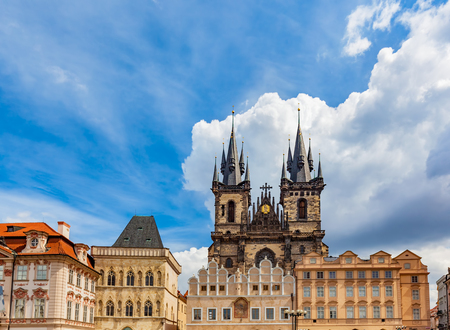 tenement: Old Town of Prague buildings, Czech Republic. View on Tyn Church and historic colorful tenement houses, blue sky. Stock Photo