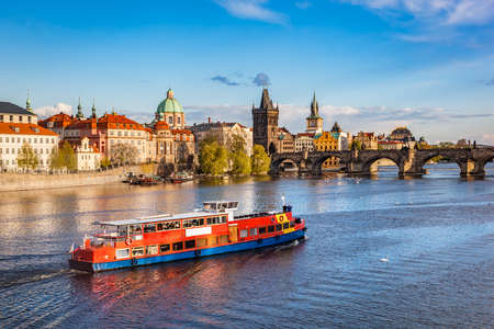 Prague, Czech Republic skyline with historic Charles Bridge. Boat cruise on Vltava river