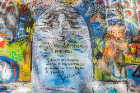 regime: PRAGUE, CZECH REPUBLIC - APRIL 29, 2016: John Lennon Wall has been filled with Lennon inspired graffiti and lyrics from Beatles songs since the 1980s as irritation of the communist regime.