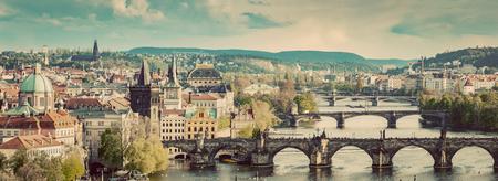 Prague, Czech Republic bridges skyline with historic Charles Bridge and Vltava river in the afternoon. Vintage