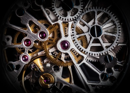 Mechanism, clockwork of a watch with jewels, close-up. Vintage luxury background. Time, work concept. 스톡 콘텐츠