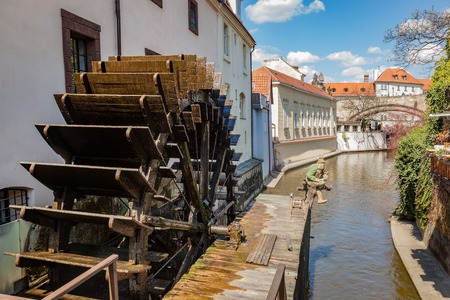 wheelhouse: Historic water mill on Kampa Island in Prague, Czech Republic. Branch of the Vltava river, the Certovka or Devils Stream