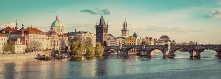 Prague, Czech Republic panorama with historic Charles Bridge and Vltava river at sunset. Vintage