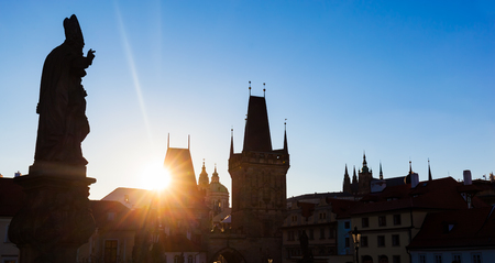 charles bridge: Charles Bridge at sunrise, Prague, Czech Republic. Dramatic statues and medieval towers. Silhouette photography style