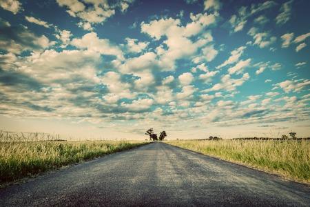bright future: Empty straight long asphalt road. Dramatic cloudy sky. Concepts of travel, adventure, destination, transport etc. Vintage style