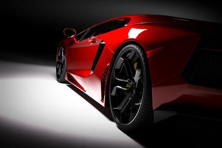 velocidad: Coche de deportes rojo rápido en proyector, fondo negro. Brillante, nuevo, luxuus. representación 3D