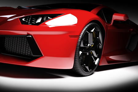 Red fast sports car in spotlight, black background. Shiny, new, luxurious. 3D rendering Фото со стока