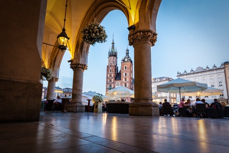 View from the Cloth Hall to the Cracow main market square and St. Marys Basilica also known as Mariacki Church.