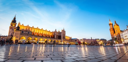 Panorama of the main old town market of Cracow. View to the Cloth Hall and St. Mary's Basilica.