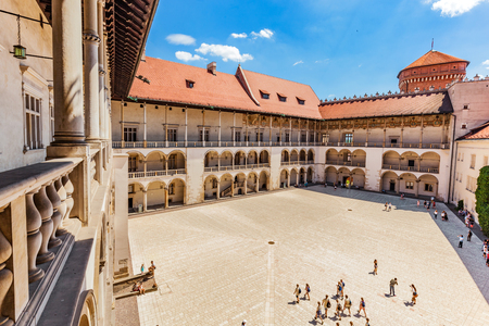 wawel: CRACOW, POLAND - June 30, 2016: Wawel Castle, Cracow, Poland. The tiered arcades of renaissance courtyard.
