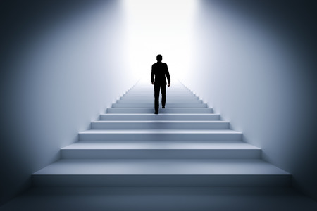 new life: Businessman climbing the stairs towards light. Concept of challenge in life, career etc. 3D illustration Stock Photo