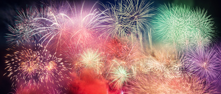 Spectacular fireworks show light up the sky. New year celebration panoramic background Stock Photo