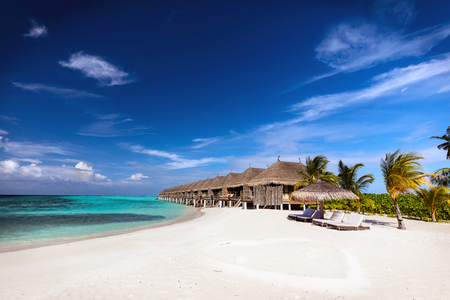 maldivian: Beach and water villas on a small island resort in Maldives, Indian Ocean. Holidays destination Stock Photo