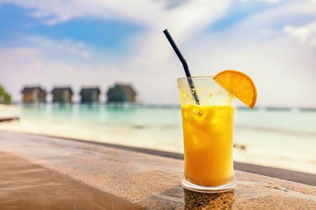 peace pipe: Fresh orange juice by the poolside. Tropical island resort in Maldives, Indian Ocean