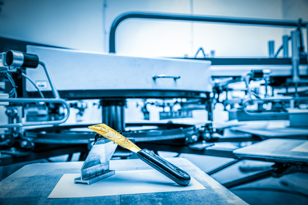 Print screening metal machine. Industrial printer. Print manufacture. 스톡 콘텐츠