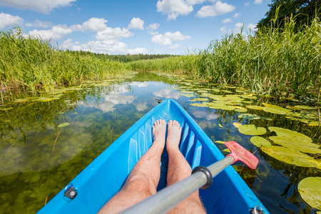 Kayaking on the river. First person perspective. Water sport, active summer vacation. Banco de Imagens