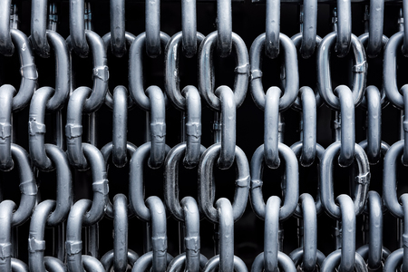 linked: Curtain of silver metallic chains. Industrial close-up shot. Stock Photo