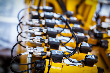 Cables and cords linkage. Mechanical devices in a railway industry. Stock Photo