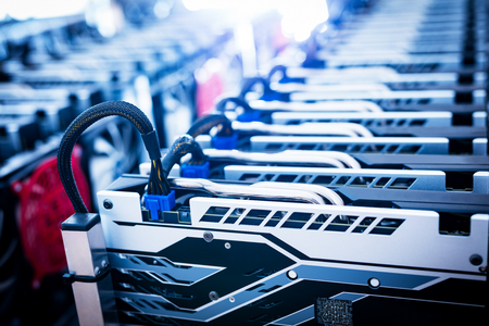Bitcoin miner. Cryptocurrency business. IT equipment. Electronic devices standing in a row.