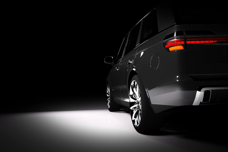 Back view of modern black SUV car in a spotlight on a black background. 3D render. Luxury cars.