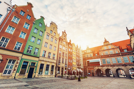 Old tenement houses and a gate in Gdansk, Poland. Travel destination. Stock Photo