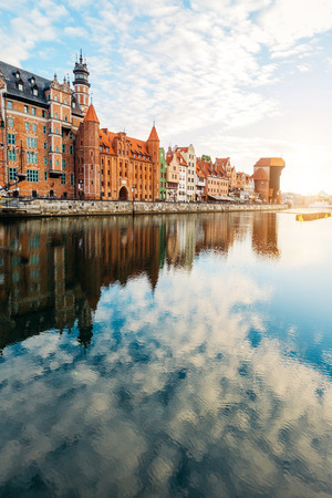 Old building in Old Town, Gdansk, and reflective Motlawa river. Poland. Tourism. Stock Photo