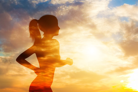 See-through silhouette of a running woman on sunset sky background. Jogging and training. Sporty lifestyle. 3D illustration. Stockfoto