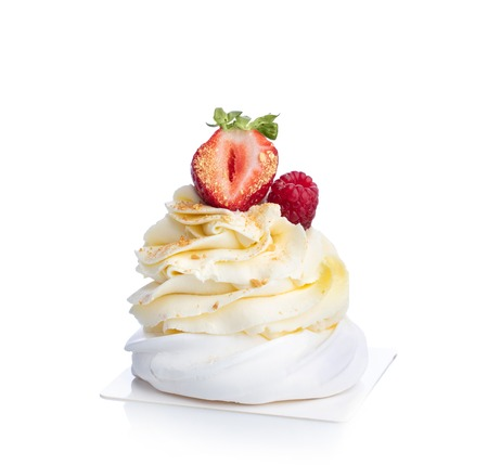 Decorated sweet dessert isolated on white background. White meringue with buttercream and fruits.
