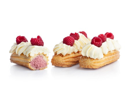 Raspberry eclairs isolated on white background. Tasty french snack.