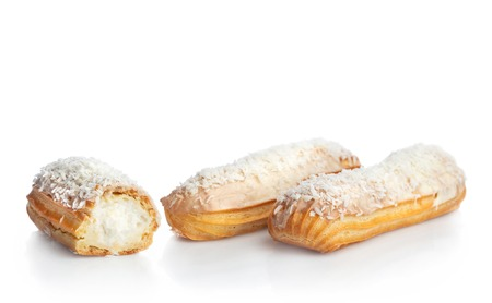 Coconut eclairs isolated on white background. Delicious french dessert.