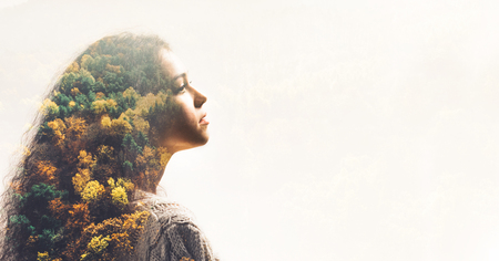 Portrait of young girl and fall forest. Double exposure effect with autumn landscape.
