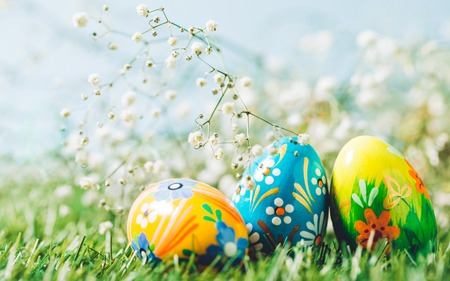 Three Easter eggs on green grass. Spring holiday, Christian tradition, symbol of life.