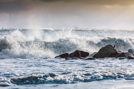 Storm waves on the ocean. Dangerous weather, natural phenomenon. Baltic Sea in Gdynia, Poland. Stock Photo